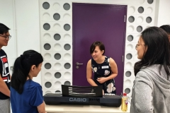 Fellow instructor Jacelyn runs through some voice exercises